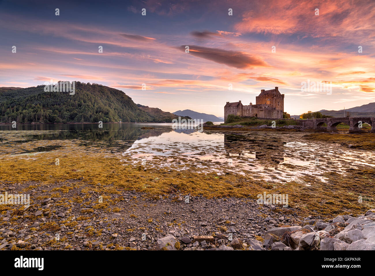 Stunning evening sky over Eilean Donan castle on the western coast of the Scottsih highlands - Stock Image