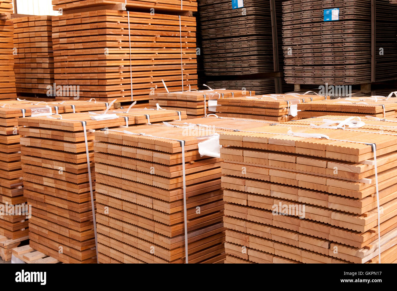 Hard wooden planks stored in a sawmill depot - Stock Image