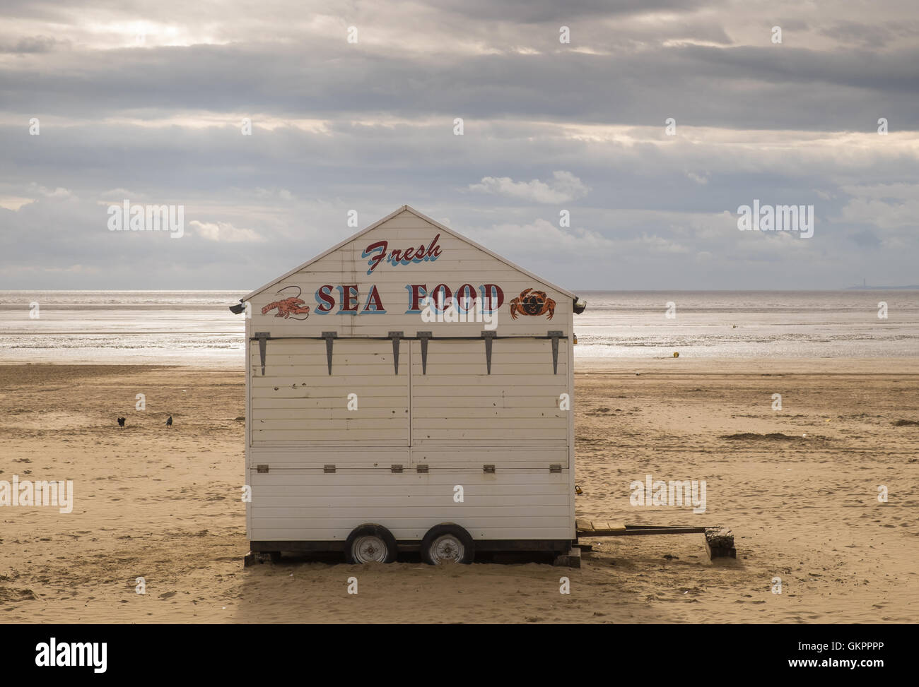 SEafood hut on the beach at Weston-Super-Mare, Somerset, England, on a stormy summer afternoon - Stock Image