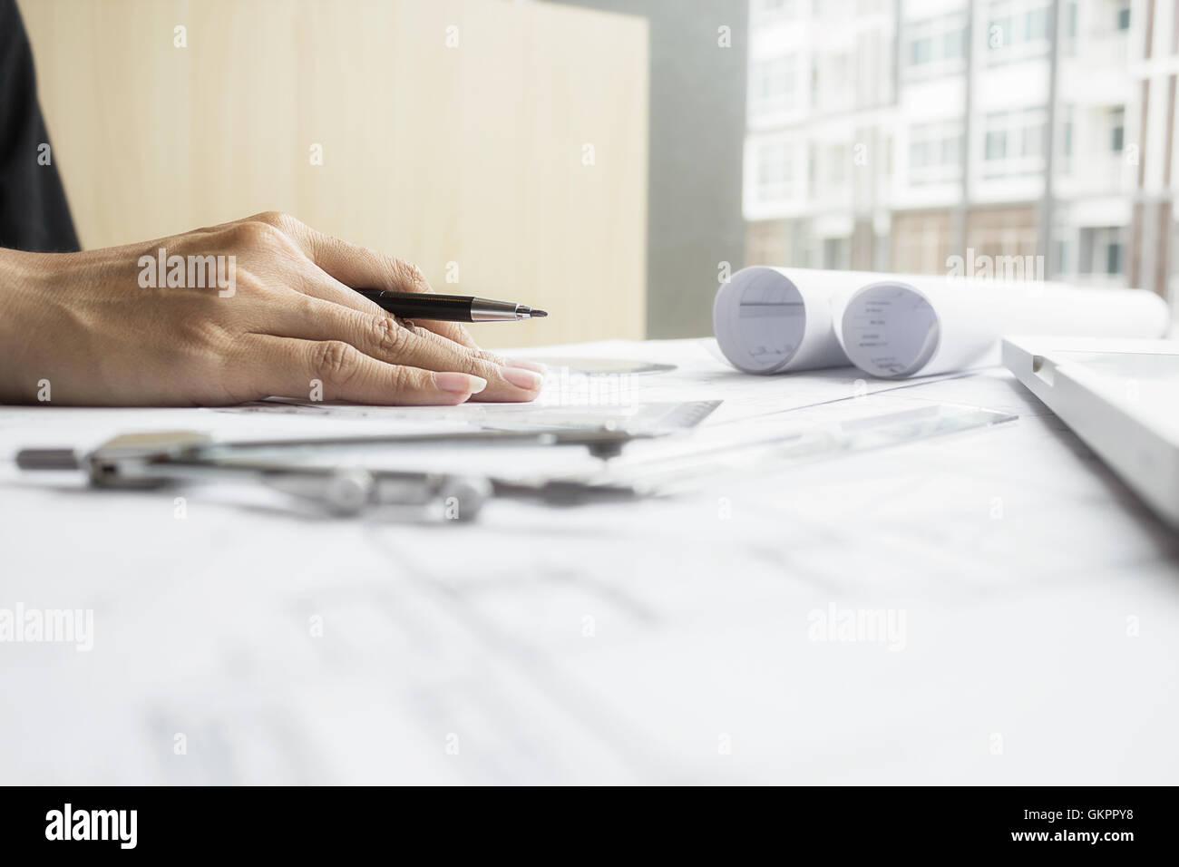 Engineer project working engineering tools workplace document engineer project working engineering tools workplace document architectural blueprint paperwork interaction holding malvernweather Gallery