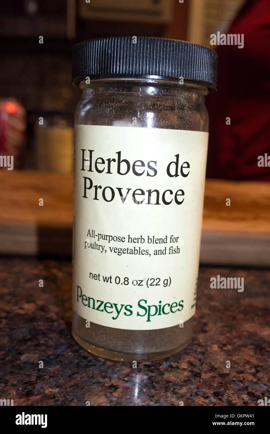 A bottle of French seasoning: Herbes de Provence. Just sprinkle on your food to make them taste yummy. St Paul Minnesota - Stock Image
