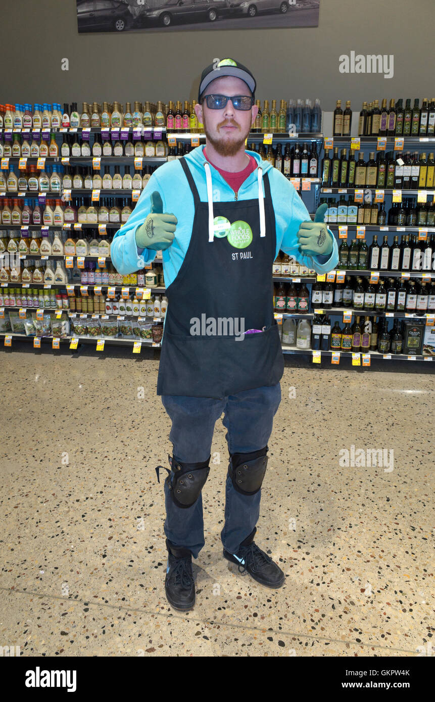 He calls himself the jack-of-all-hours. This affable grocery stocker seems to be there when ever I am. St Paul Minnesota - Stock Image