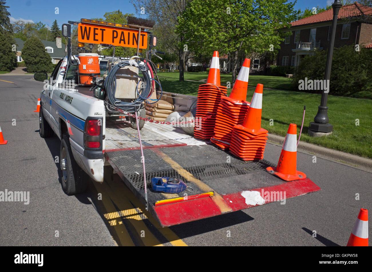 Street paint marker pickup truck carrying orange and white warning cones. St Paul Minnesota MN USA Stock Photo