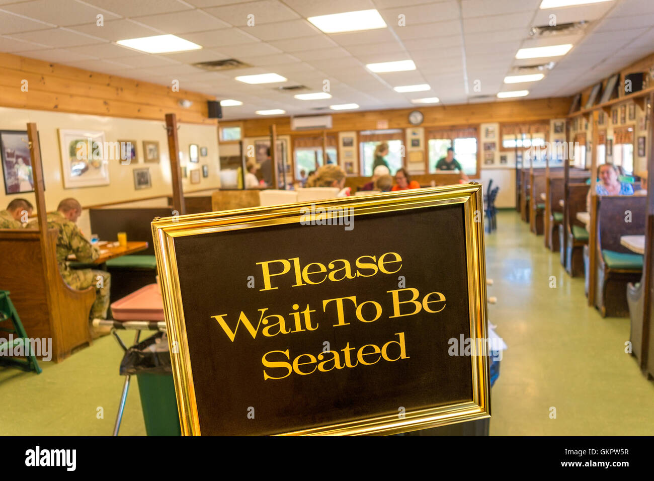 Sign Please Wait To Be Seated in a typical American Diner. Famous Moody's Diner, Waldoboro, Maine. On US Route - Stock Image