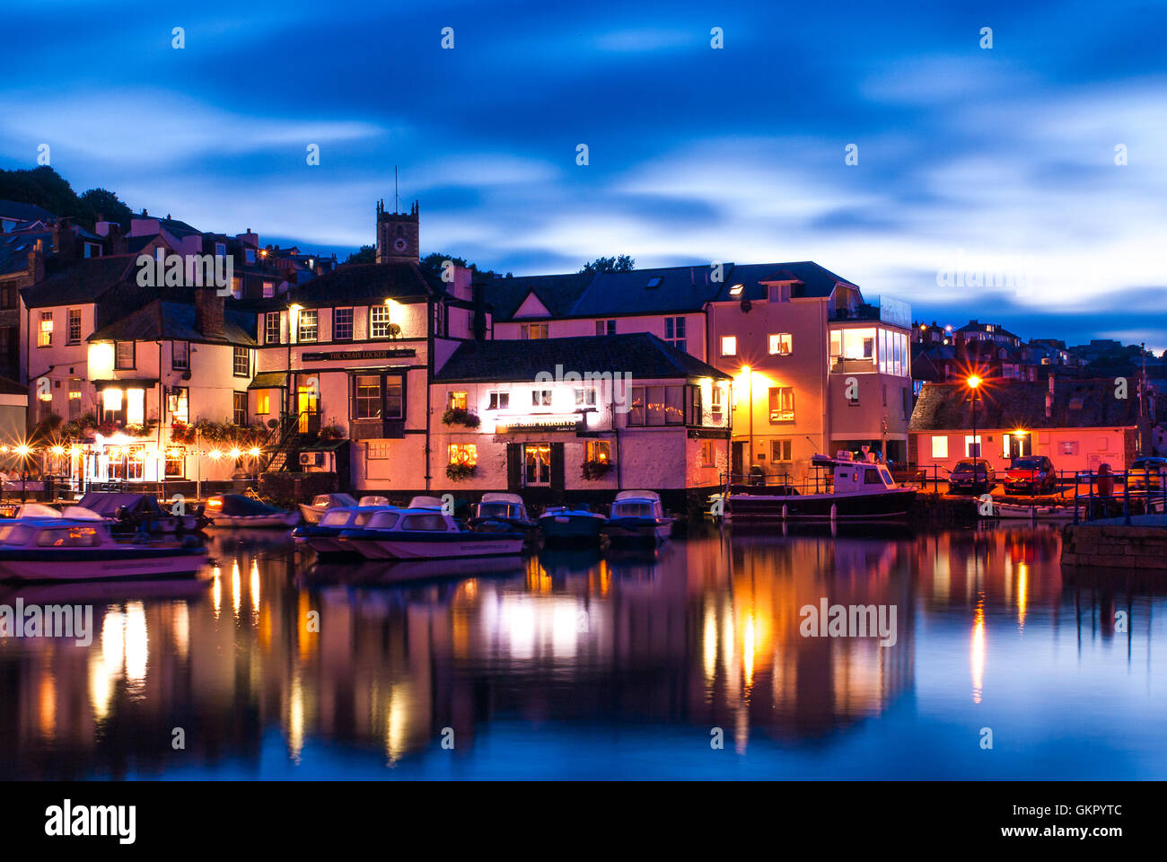 A beautiful early evening summer view of pubs at the waterfront in Falmouth. A typical view of Cornwall in Summer. - Stock Image