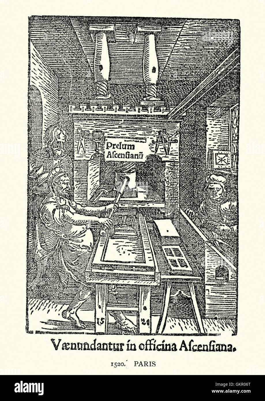 Early french woodcut of a man using a printing press, Paris, c. 1520 - Stock Image