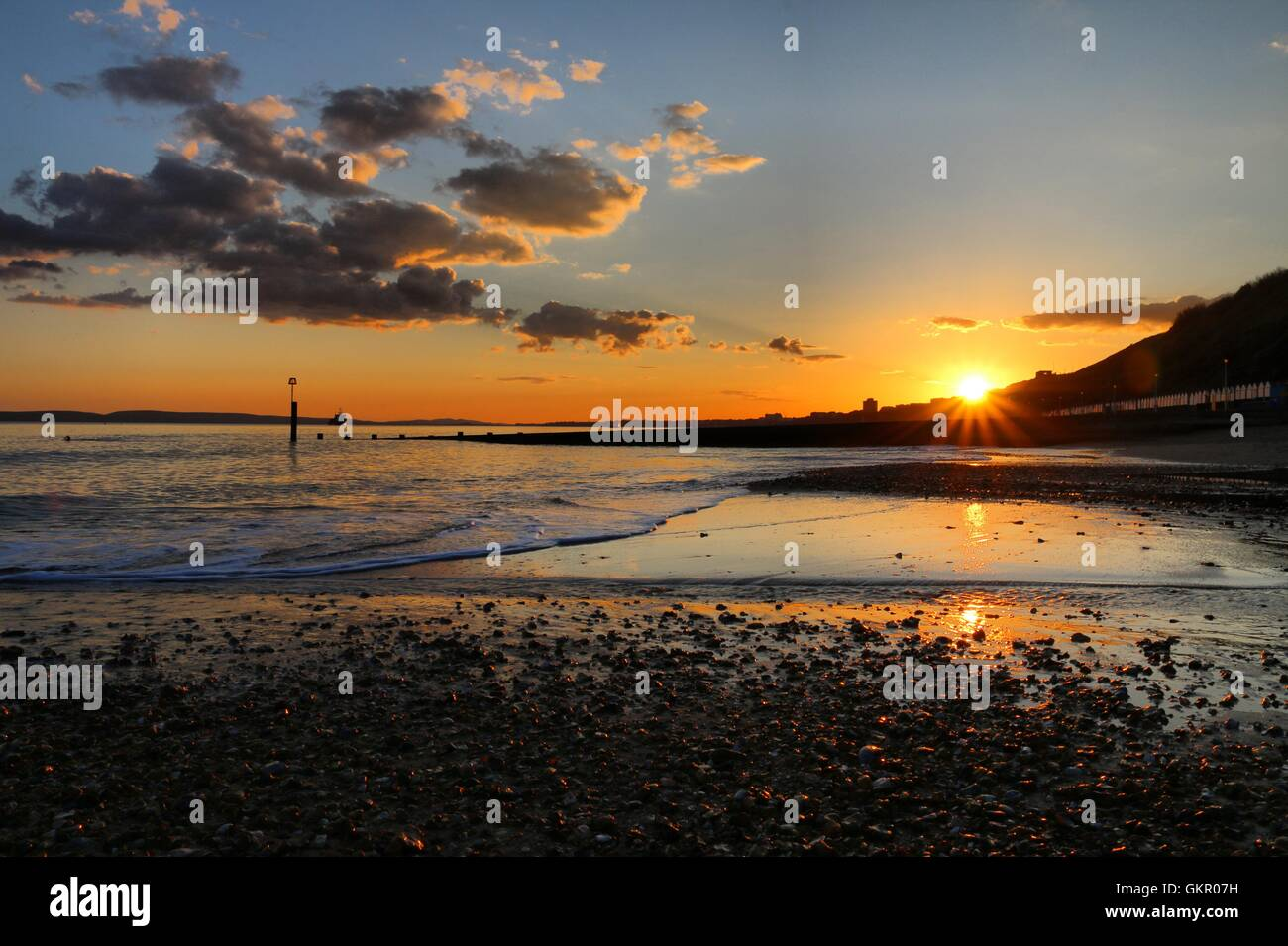 Southbourne Beach with clouds at Sunset Stock Photo