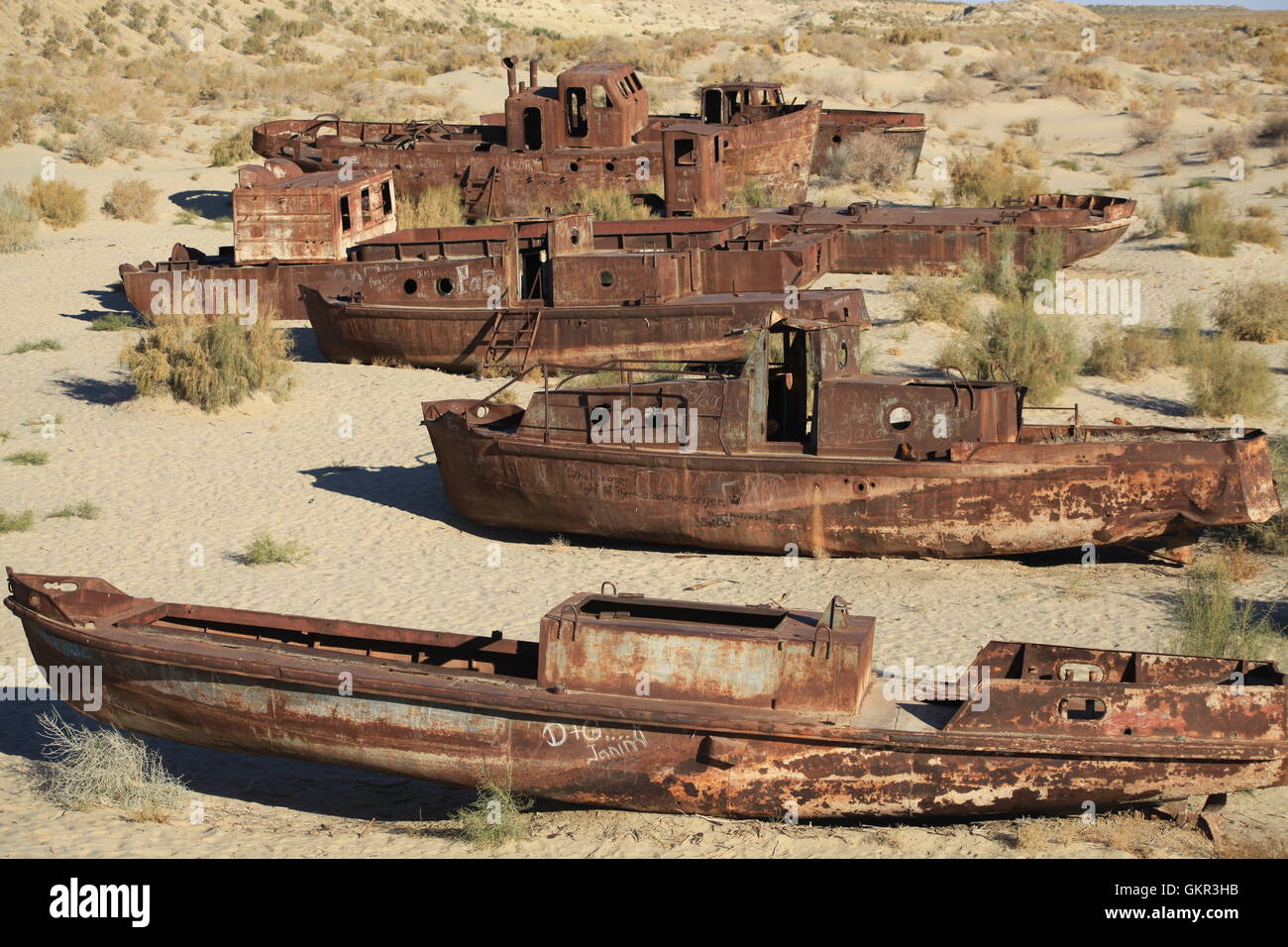 Rusted ships on the former seabed of Aral Sea near Moynaq, Uzbekistan. - Stock Image