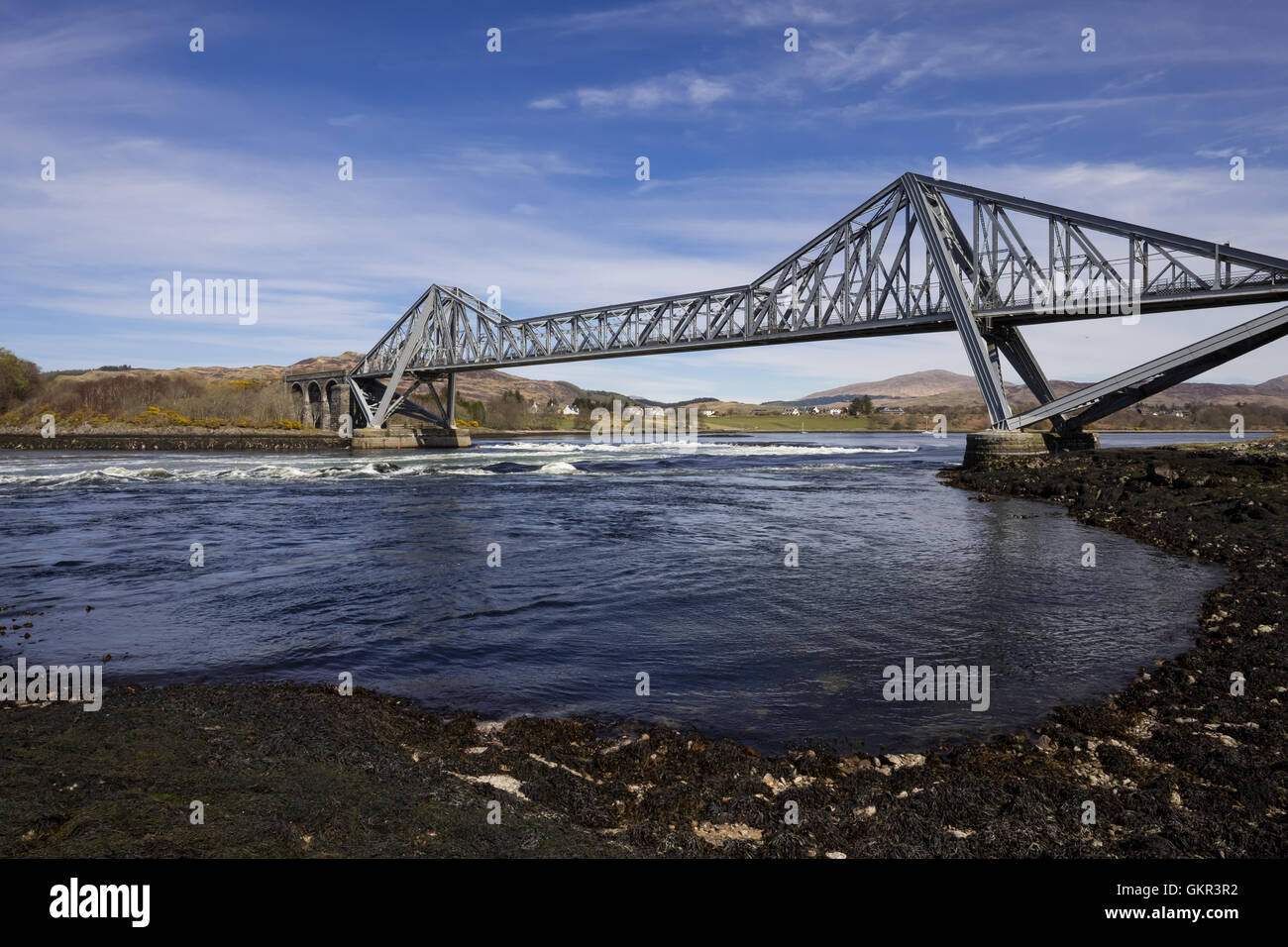 The Falls of Lora, a tidal race at the mouth of Glen Etive & Connel Bridge, a cantilever bridge in Scotland - Stock Image
