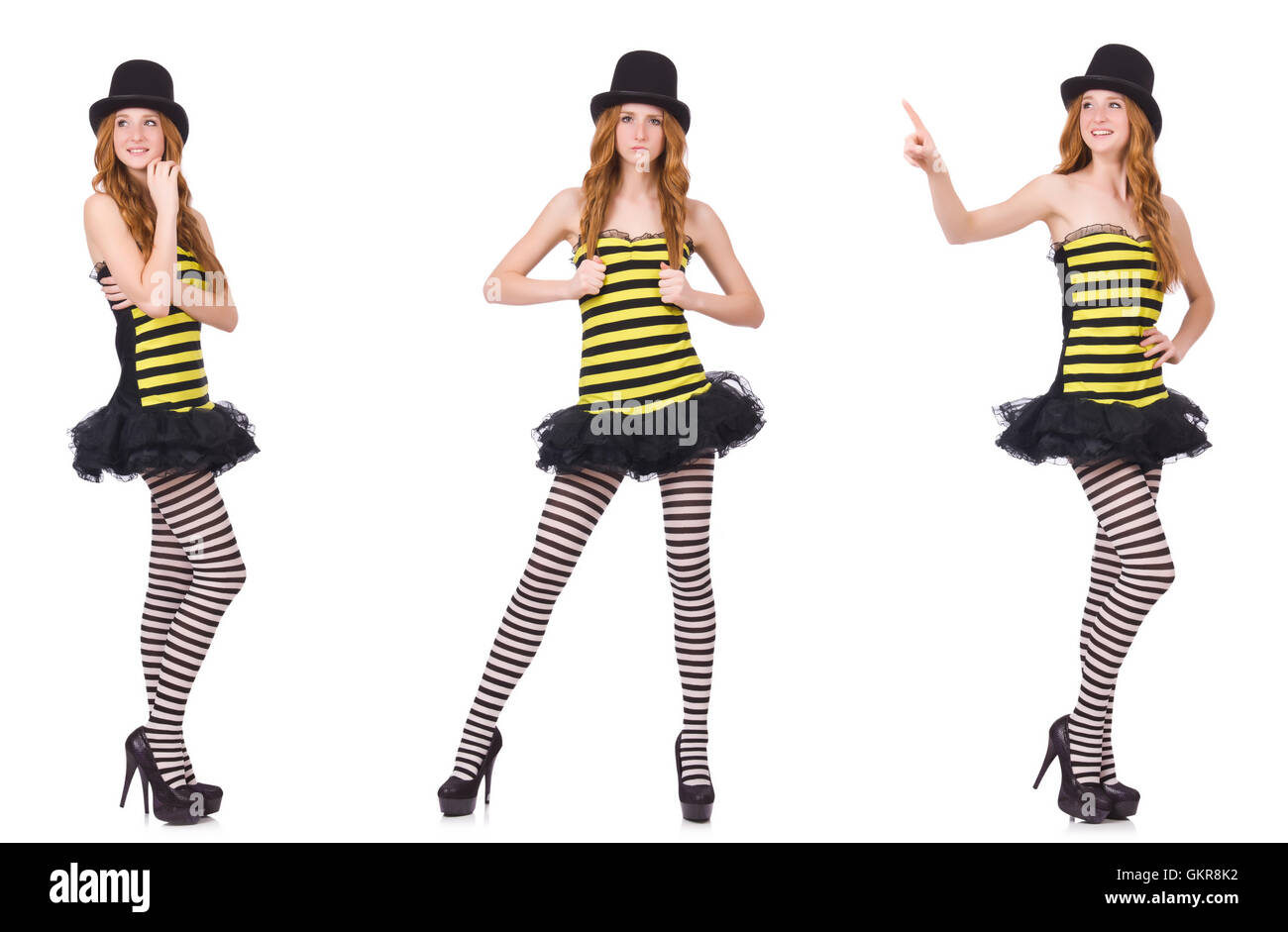 20f042dea01d1 A girl in black and yellow striped dress isolated on white - Stock Image