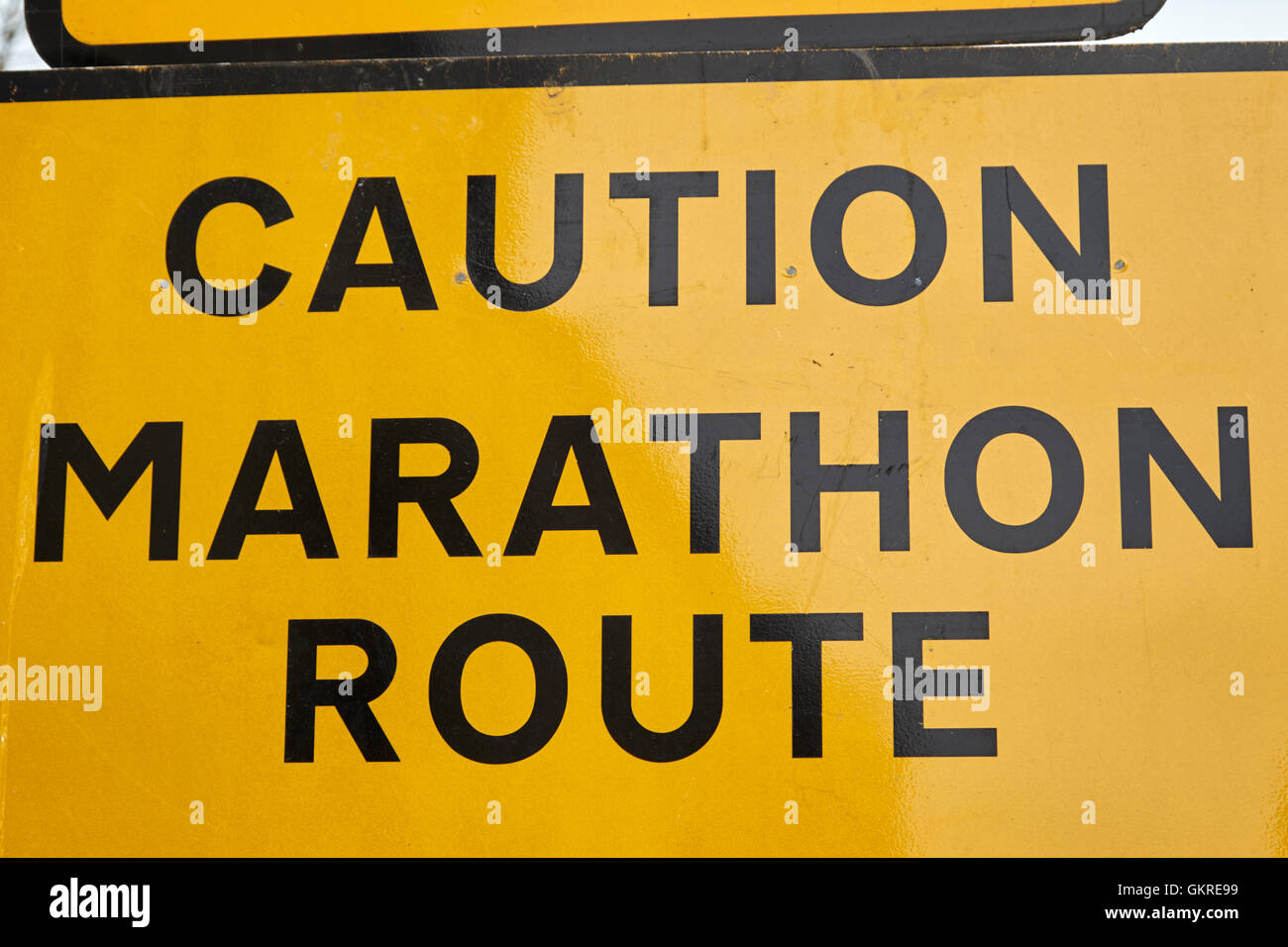 yellow caution marathon route road traffic warning and diversion signs in the uk - Stock Image