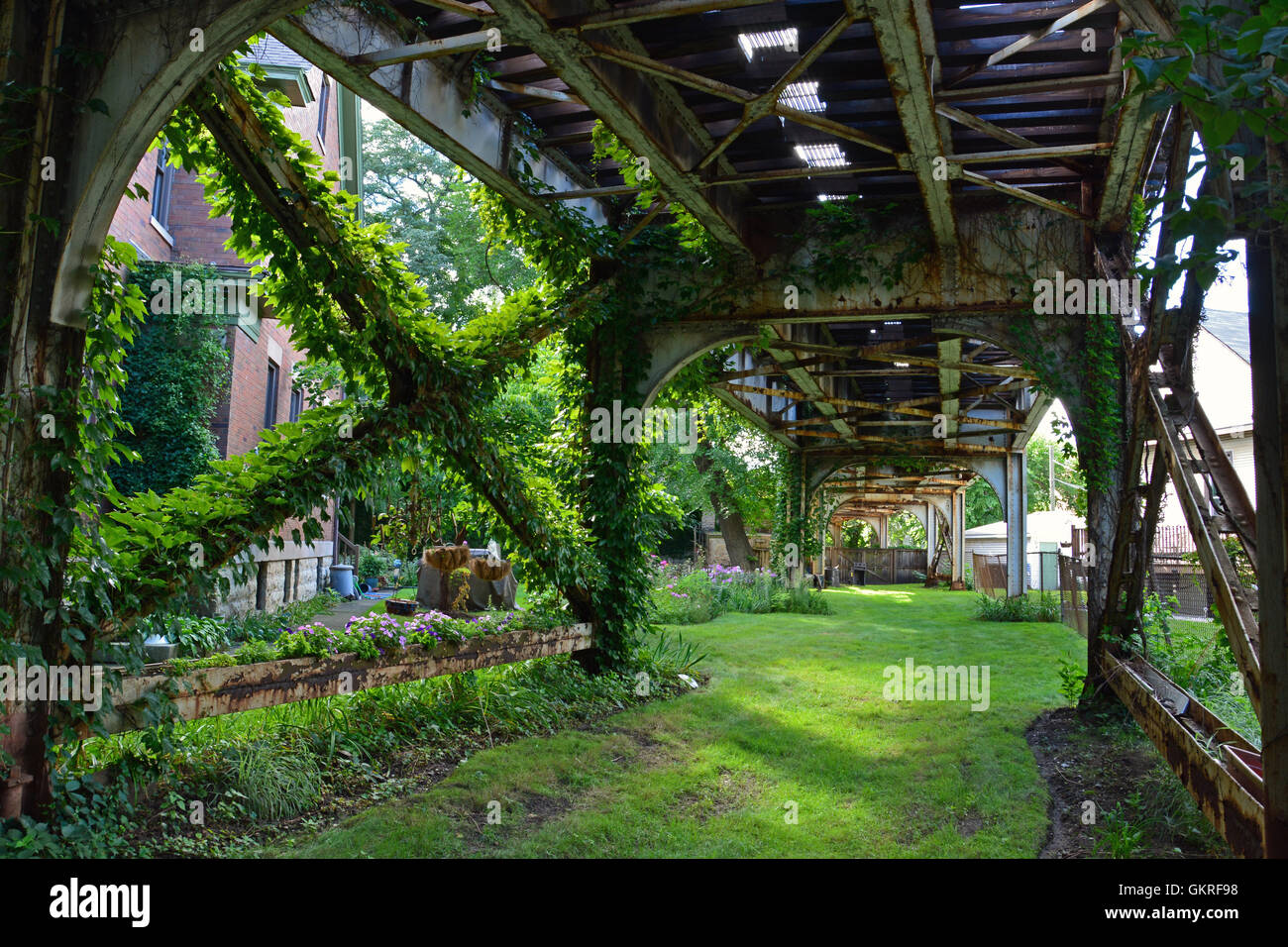The Brown Line Elevated CTA Train Tracks Passing Through Urban Gardens In  The Residential Neighborhood Of Ravenswood In Chicago.