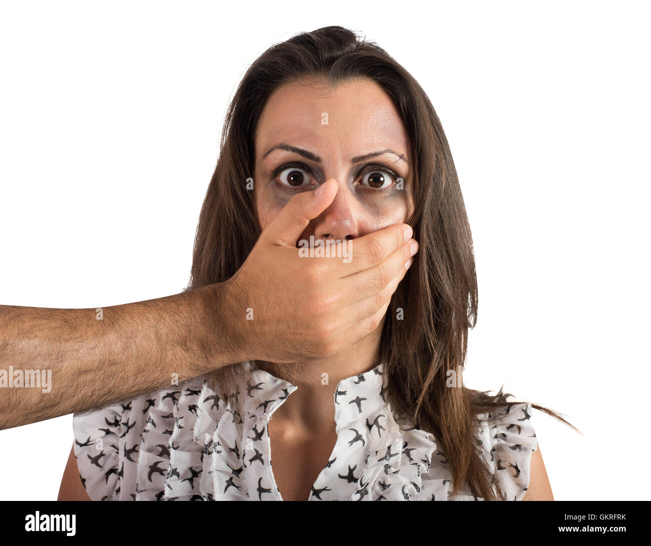 Woman terrified by the violence - Stock Image