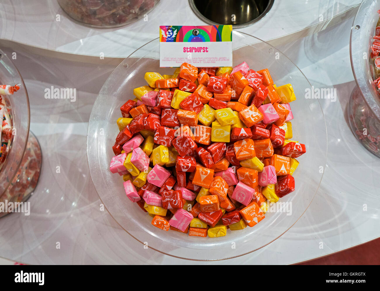 Interior of IT'SUGAR store on Broadway in Greenwich Village. A display of STARBURST candy for sale by the ounce. - Stock Image