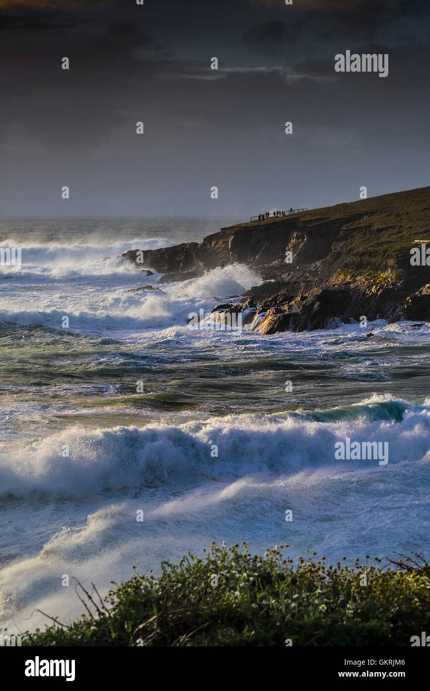 Gale force winds and weather drive large waves onto the rocks at Towan Headland in Newquay, Cornwall. - Stock Image