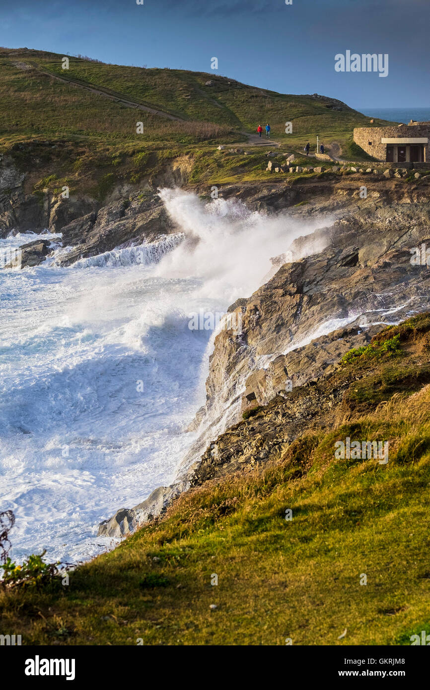 Windy weather drives large waves onto rocks on to Towan Headland in Newquay, Cornwall. - Stock Image
