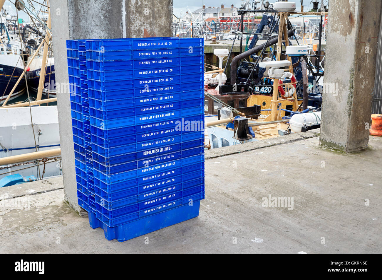 pile of empty fish crates on the pier at portavogie county down northern ireland - Stock Image