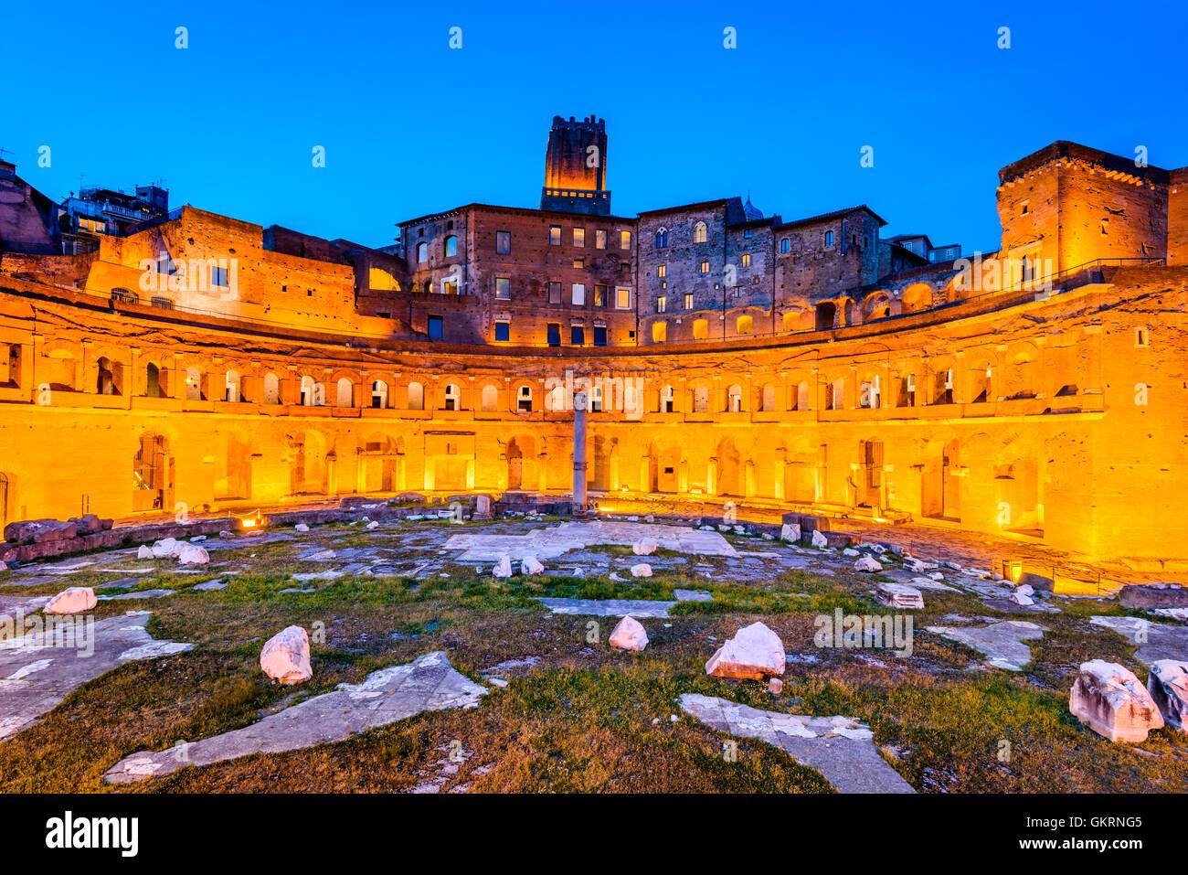 Rome, Italy. Twilight view of ancient Trajan's Market, ruins in Via dei Fori Imperiali, Roma. - Stock Image