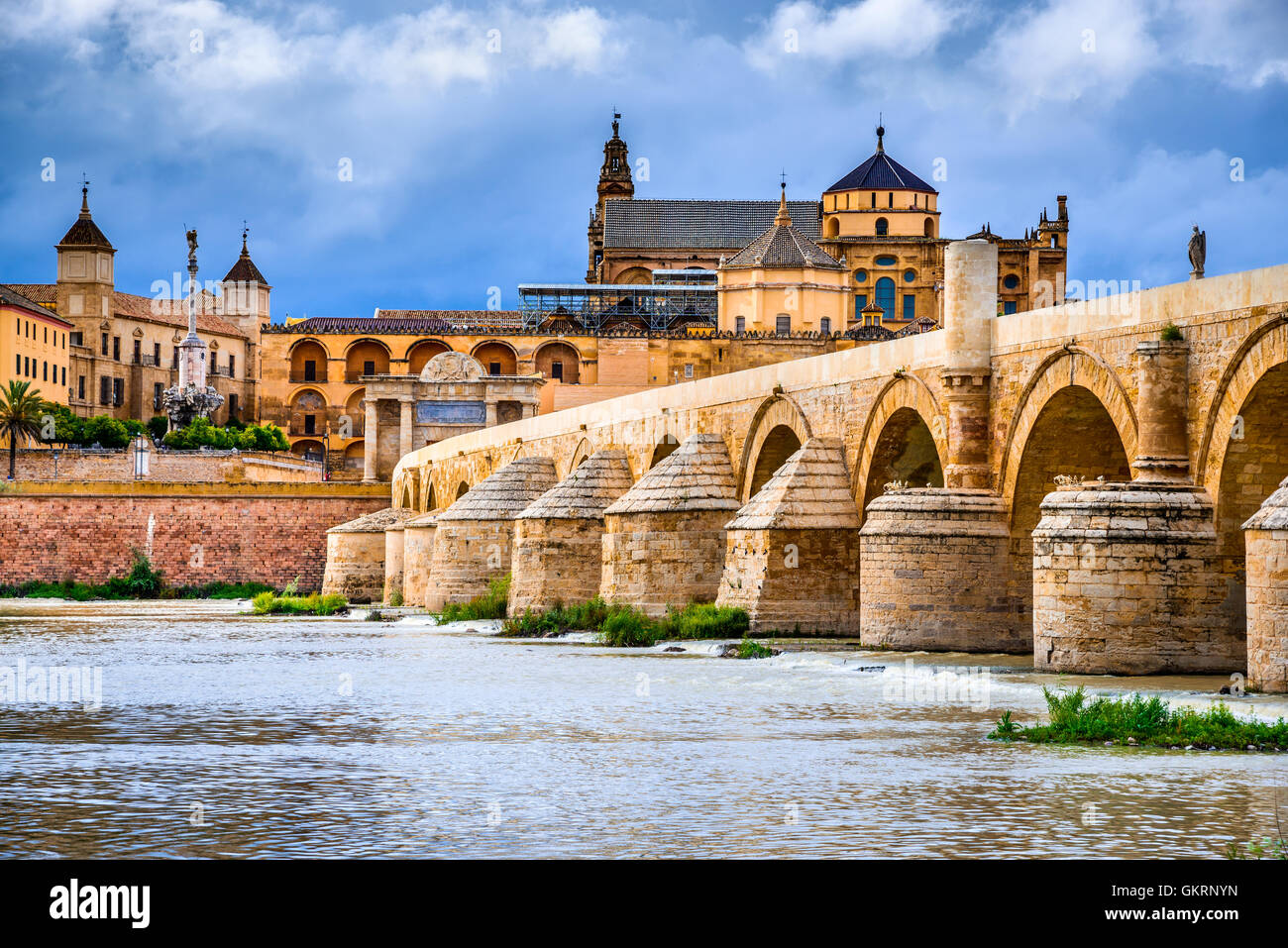 Cordoba, Spain, Andalusia. Roman Bridge on Guadalquivir river and The Great Mosque (Mezquita Cathedral). - Stock Image