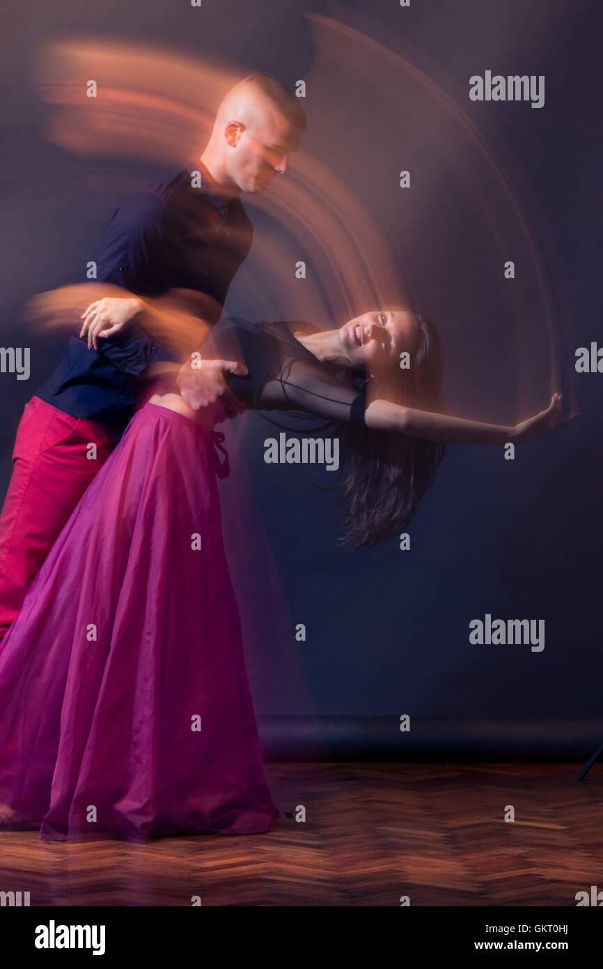 Young dance couple man woman motion blur long exposure - Stock Image