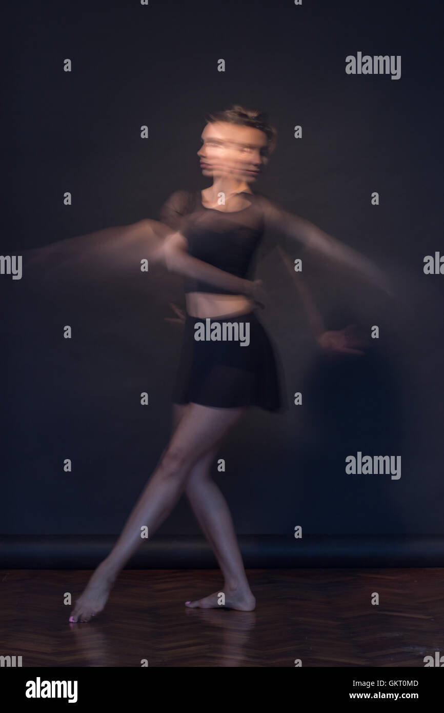 Young ballerina motion blur moving - Stock Image