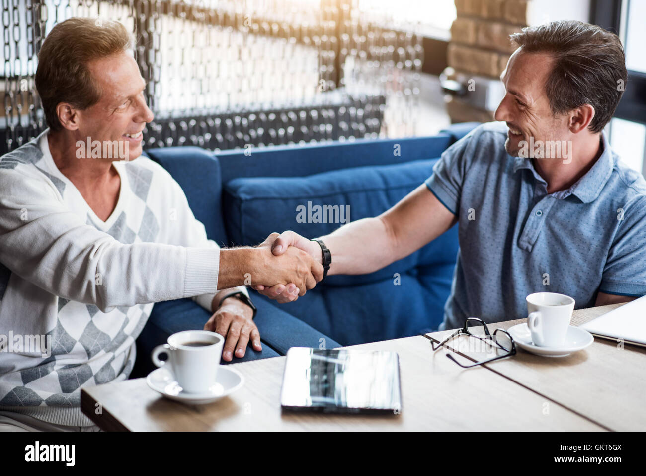 Two men working together - Stock Image