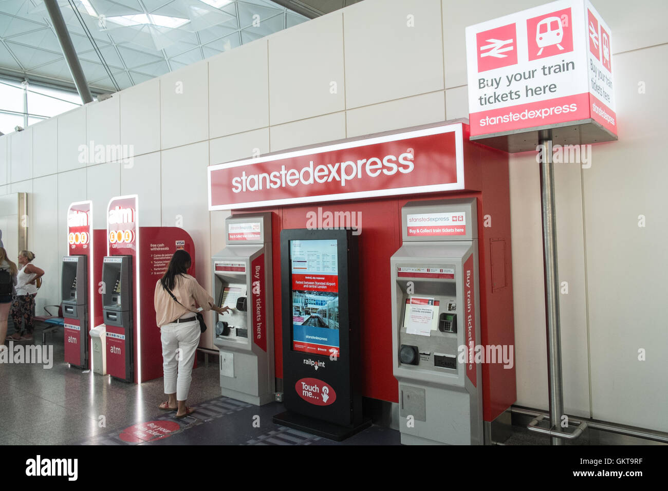 Station ticket machine.Terminal at Stansted Airport,Essex,London. Budget airlines,including Ryanair and Easyjet - Stock Image