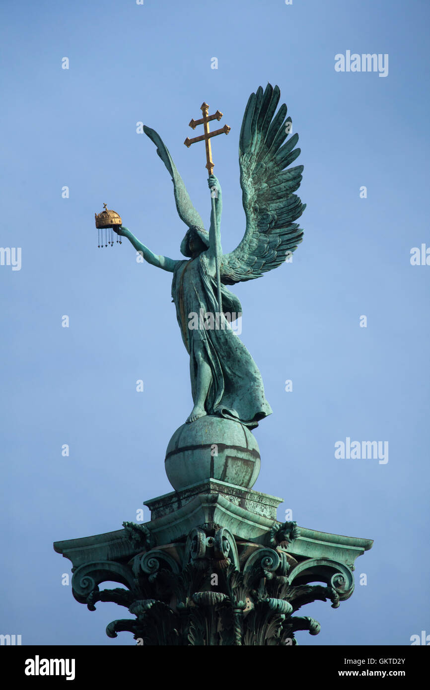 Archangel Gabriel holding the Holy Crown of St. Stephen and the apostolic double cross. Statue by Hungarian sculptor Stock Photo