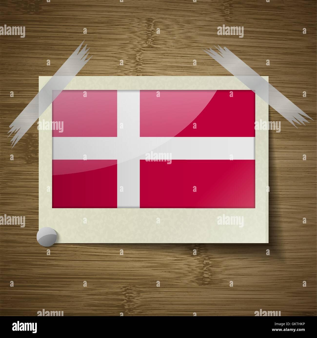 Flags Denmark at frame on wooden texture. Vector Stock Vector