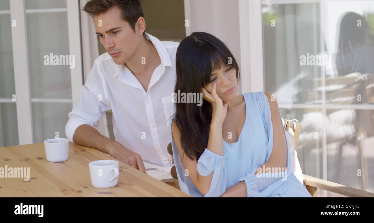 Angry young couple sulking after an argument - Stock Image