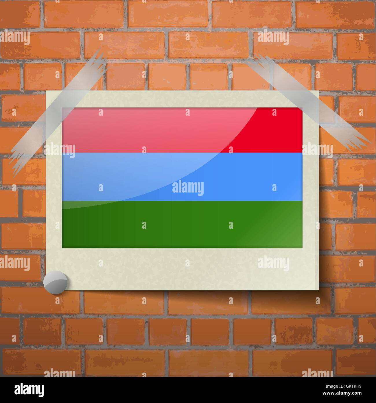 Flags Karelia scotch taped to a red brick wall - Stock Image