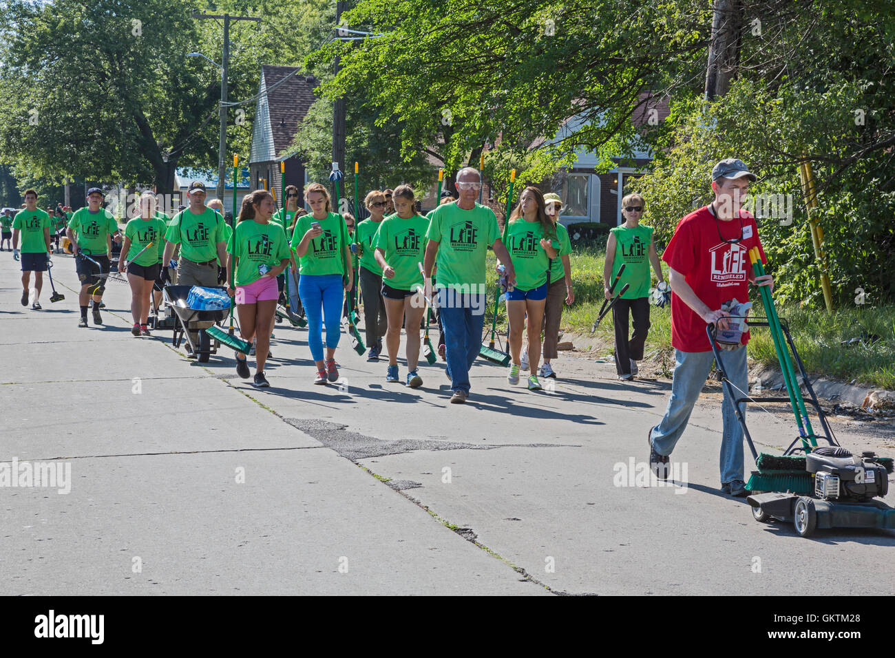 Detroit, Michigan - Volunteers clean up a distressed neighborhood during a week-long community improvement initiative. Stock Photo