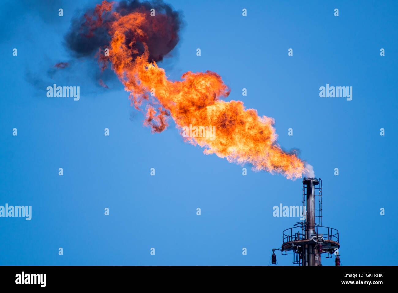 flaring of associated gas at oil refinery - Stock Image