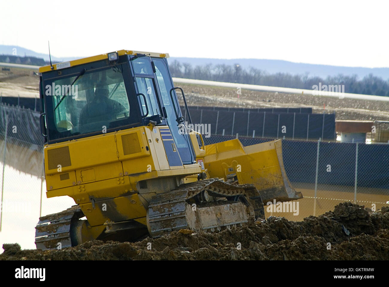 Rear View Of Bulldozer On Construction Site - Stock Image