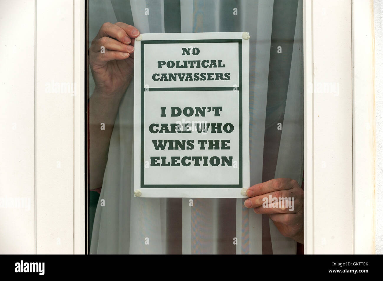A disgruntled voter expresses their opinion on politicians and campaigners. Stock Photo