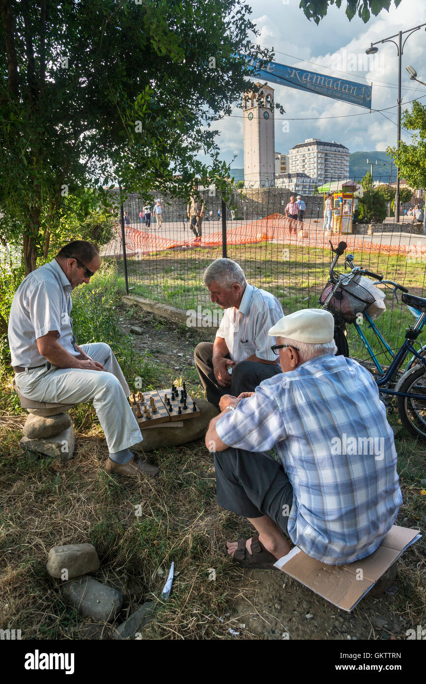 Men playing chess, a popular pastime in Albania, in the park at Elbasan,  Central  Albania, - Stock Image
