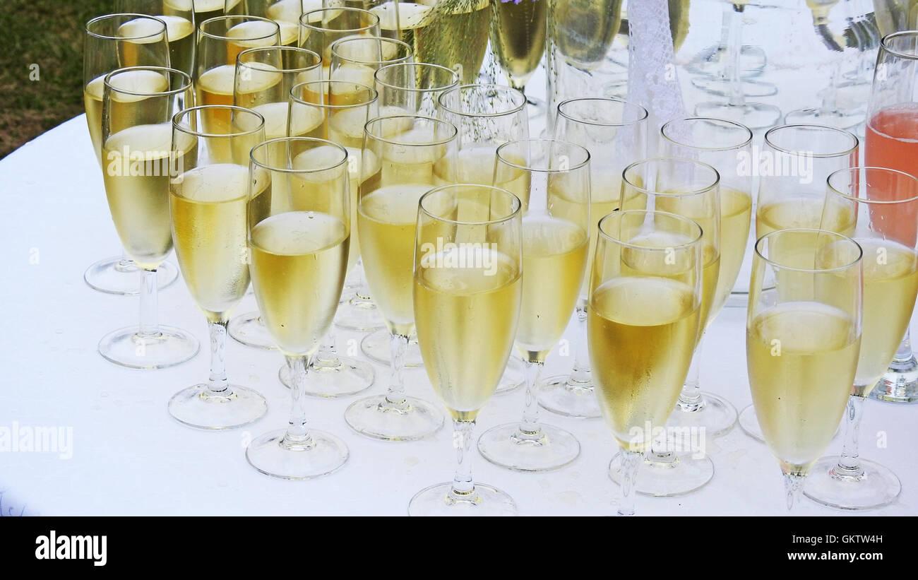 Several white champagne glasses. - Stock Image