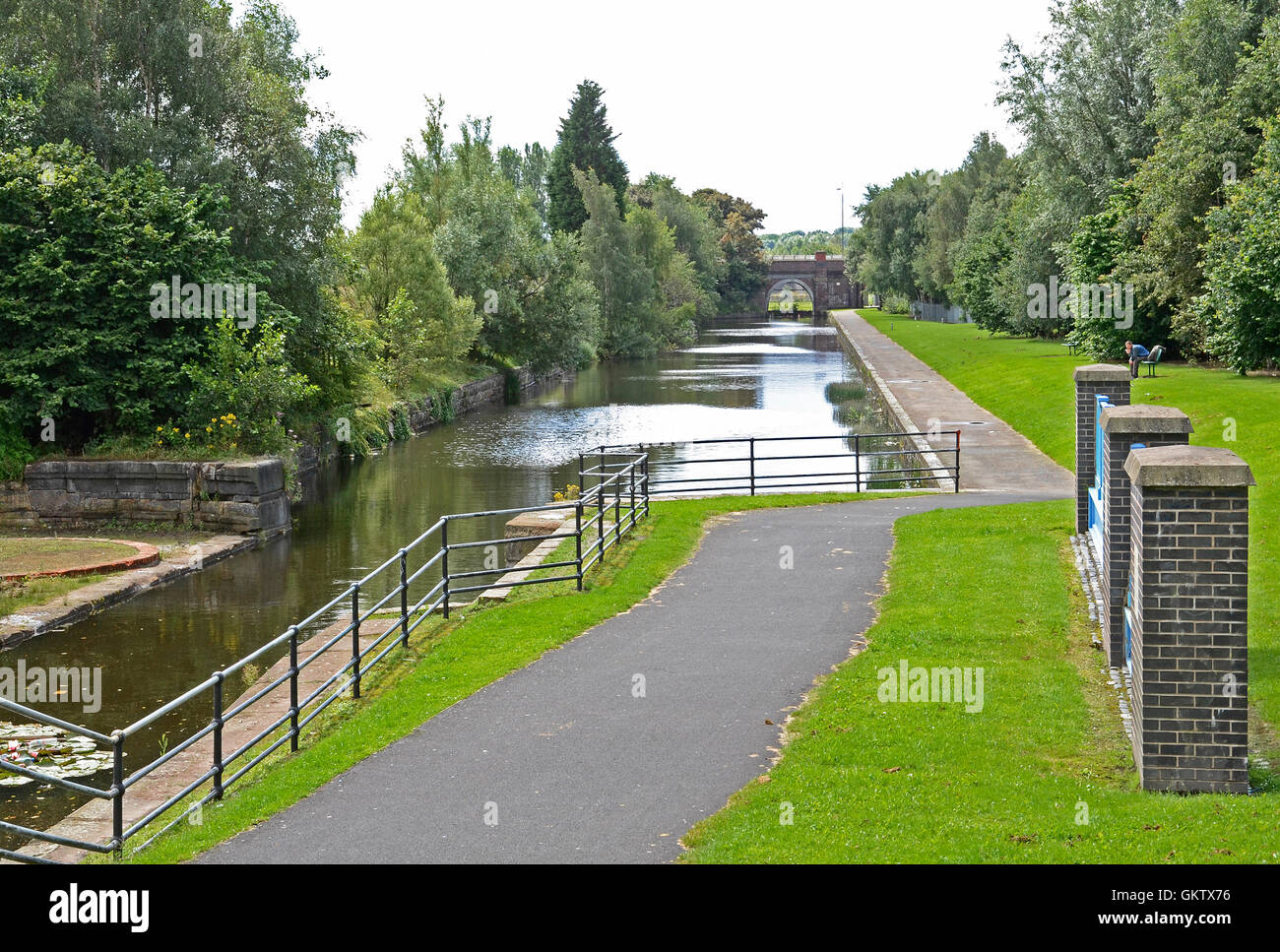 The Sankey canal at St.Helens in Merseyside, UK, the canal no longer used by boats in now a linear park. - Stock Image