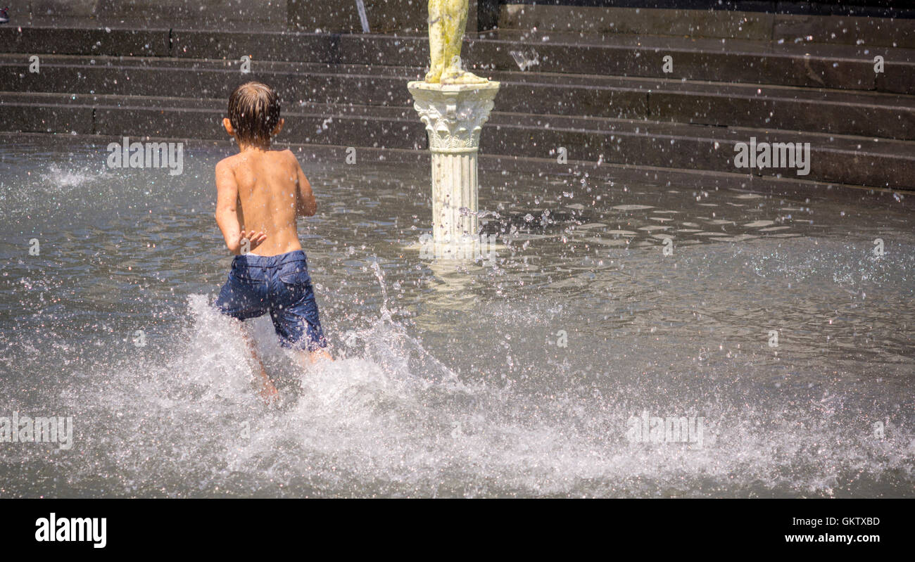 New Yorkers and visitors enjoy the fountain in Washington Square Park in Greenwich Village in New York on Saturday, - Stock Image