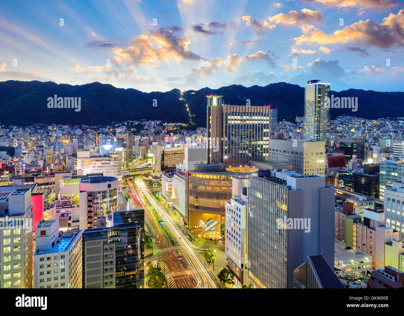 Kobe, Japan downtown skyline in the Sannomiya District against the backdrop of the Rokko Mountains. - Stock Image