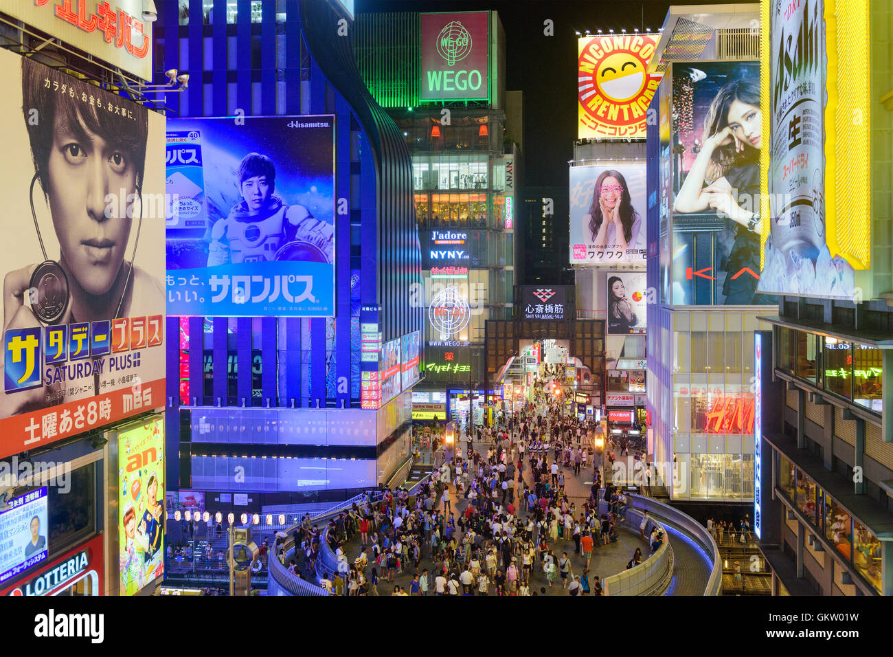 OSAKA, JAPAN - AUGUST 16, 2015: Pedestrians on Ebisu Bridge pass over Dotonbori Canal in the Namba District. The - Stock Image