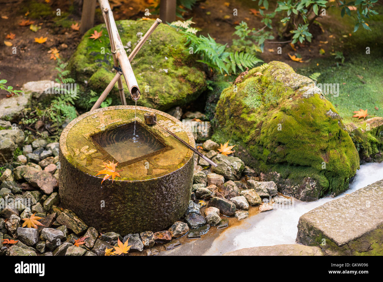 Traditional basin for hand washing in Kyoto, Japan. - Stock Image