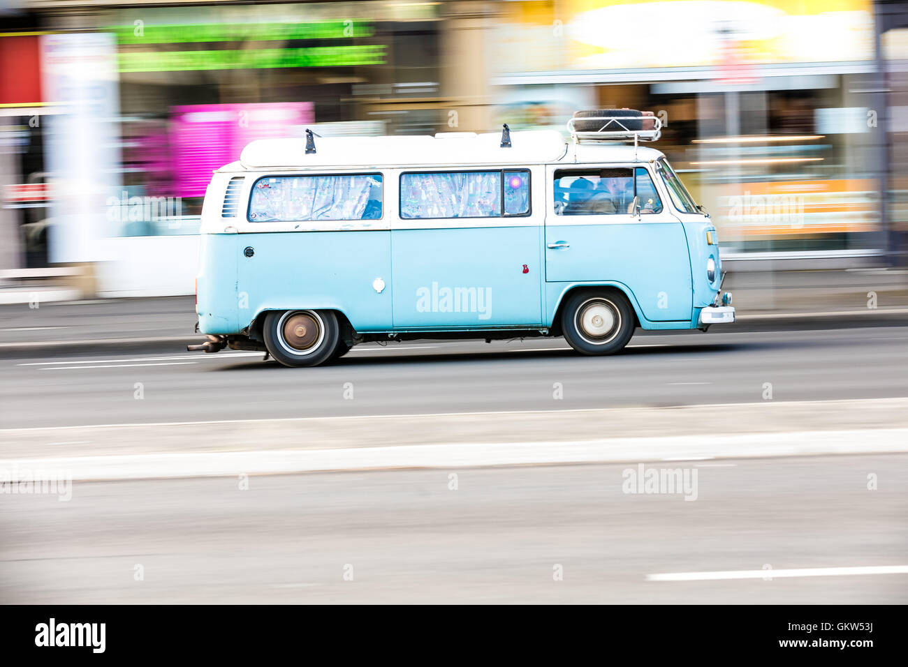 A VW Campervan travelling down the road - Stock Image