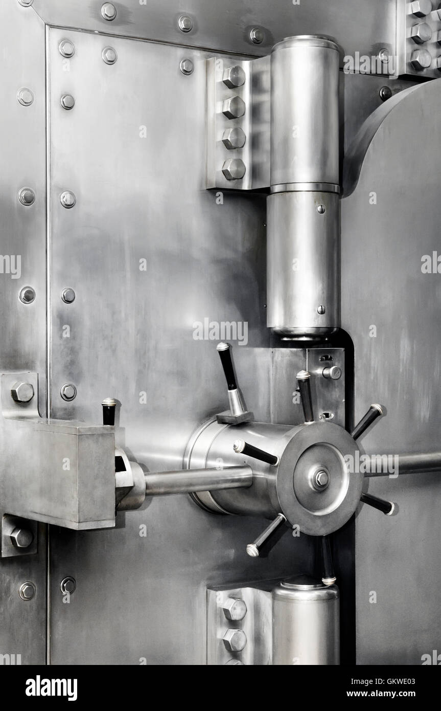 Bank vault stainless steel safe door lock and hinges. Banking, safety deposit, security concept. - Stock Image