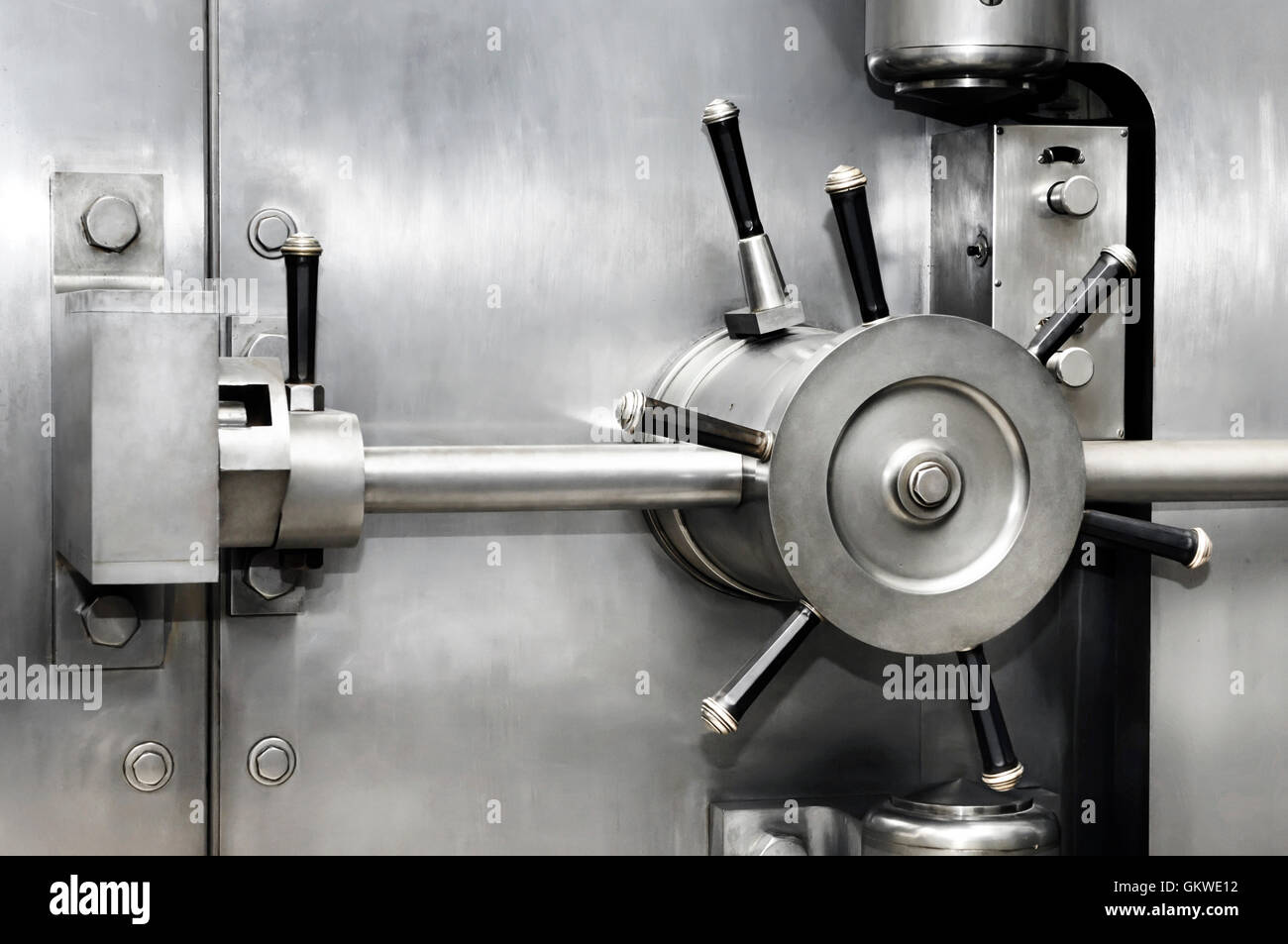 Shiny stainless steel bank vault safe door lock. Banking, security, investment concept. - Stock Image