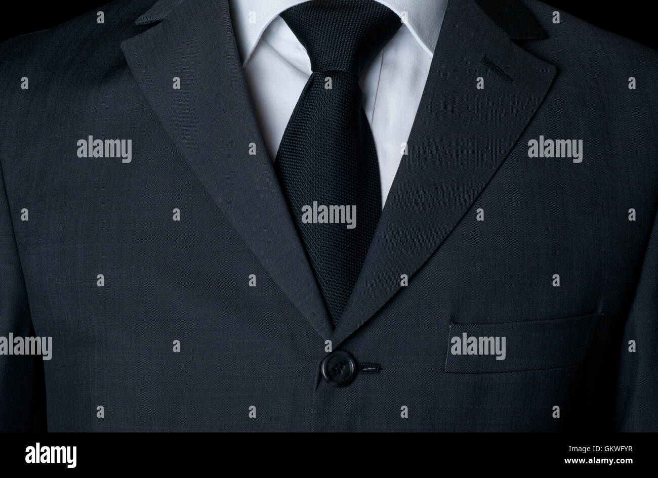 Dark business suit with a tie - Stock Image