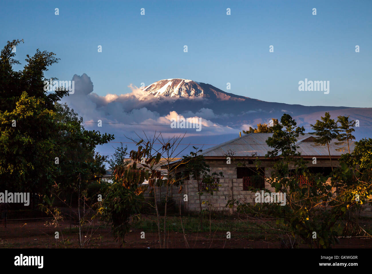 A view of mount kilimanjaro from the small town of Moshi, Tanzania - Stock Image