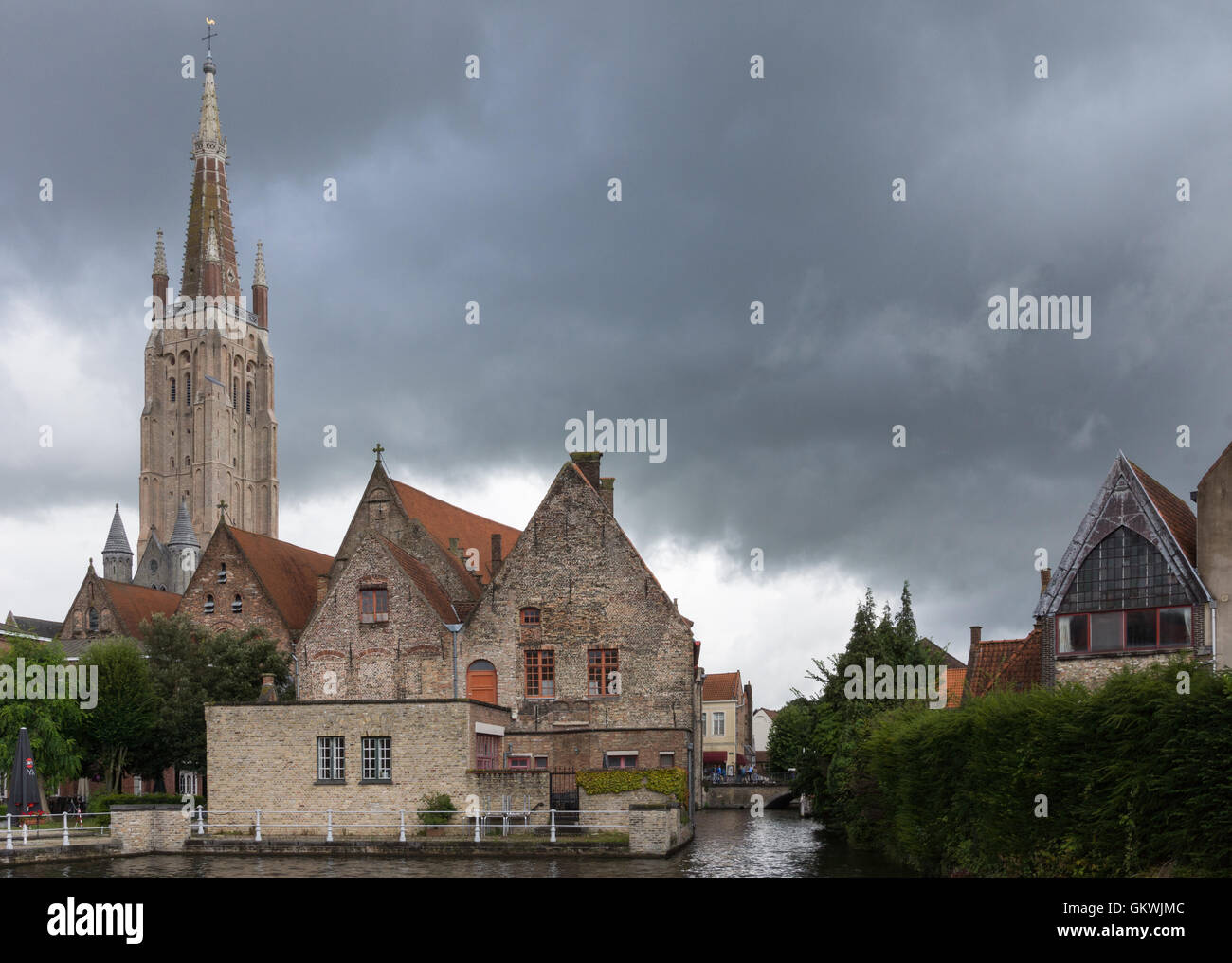 Onze-Lieve-Vrouw Cathedral behind Old Sint Jans Hospital. - Stock Image