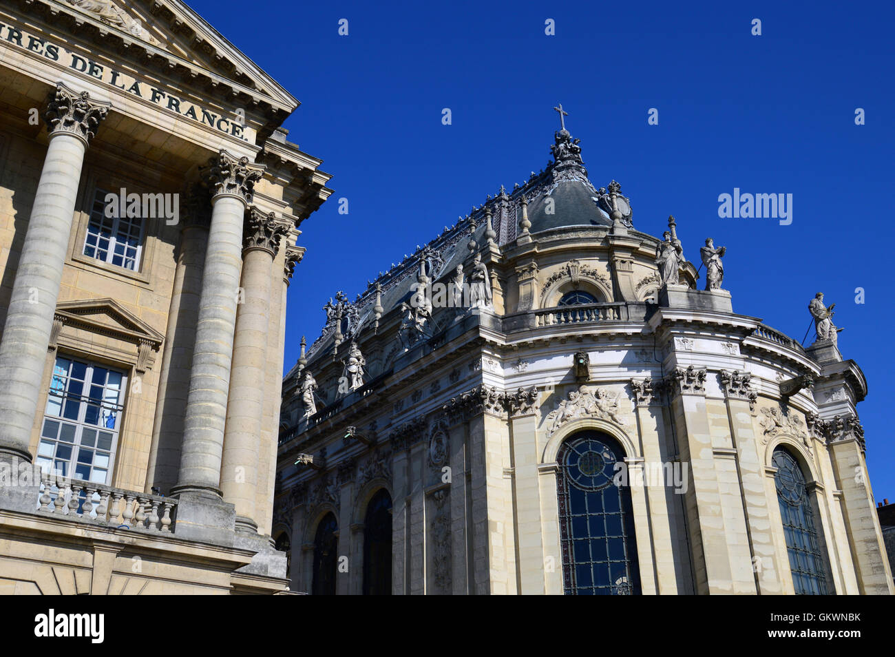 VERSAILLES, FRANCE - April 19, 2015: Ornamented buildings of the Royal Chapel in front of the Palace of Versailles, - Stock Image