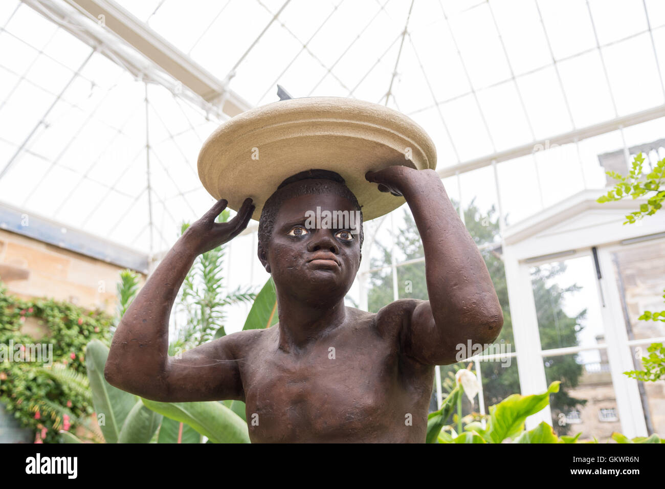 Wentworth Castle Conservatory - Blackamoor Statue, also known as the Kneeling Slave - symbolising the profitability - Stock Image